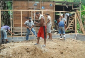 Helping Rebuild Dona Blanca's home